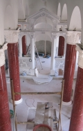 Red scagliola columns before finishing details