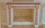 Fireplace with red scagliola surface on top