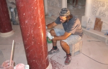Polishing scagliola column in St. John's Cathedral, Andros