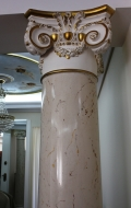 Gilded Ionic capital detail