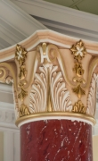 Close-up of gilded capital of red scagliola column