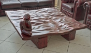 Red scagliola table and statuette