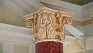 Big red scagliola column with gilded details