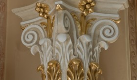 White scagliola column with gilded details